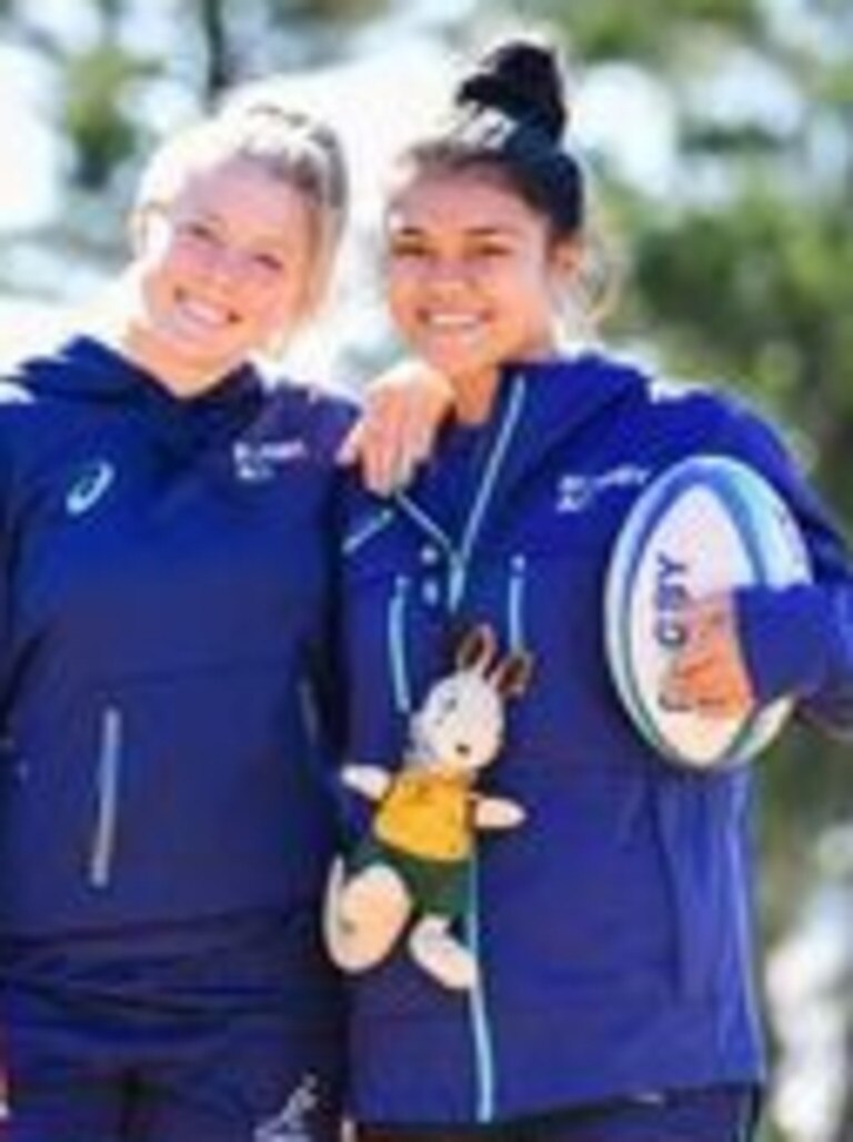 Wallaroos Samantha Treherne (left) and young gun Alysia Lefau-Fakaosilea with Wallaroos mascot as youngest in the team at 18. Photo: Stu Walmsley, Rugby Aust Media
