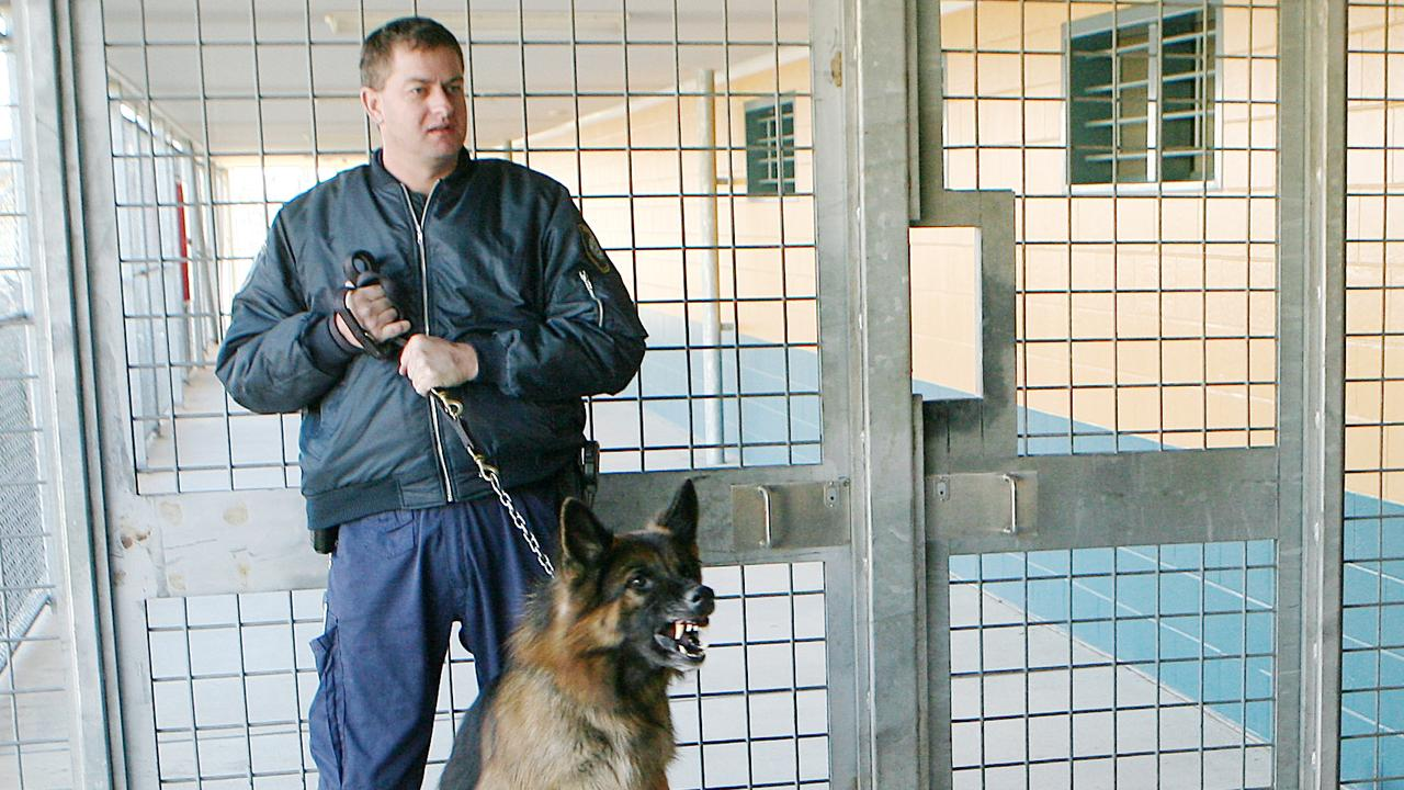 A prison guard inside Wolston Correctional Centre. Picture: Peter Wallis