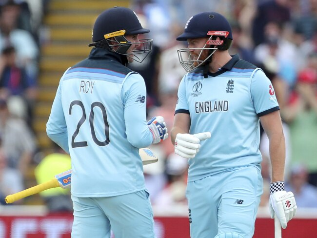 England's Jason Roy, left, celebrates with batting partner Jonny Bairstow after hitting a boundary during the Cricket World Cup semi-final match between England and Australia at Edgbaston in Birmingham, England, Thursday, July 11, 2019. (AP Photo/Aijaz Rahi)