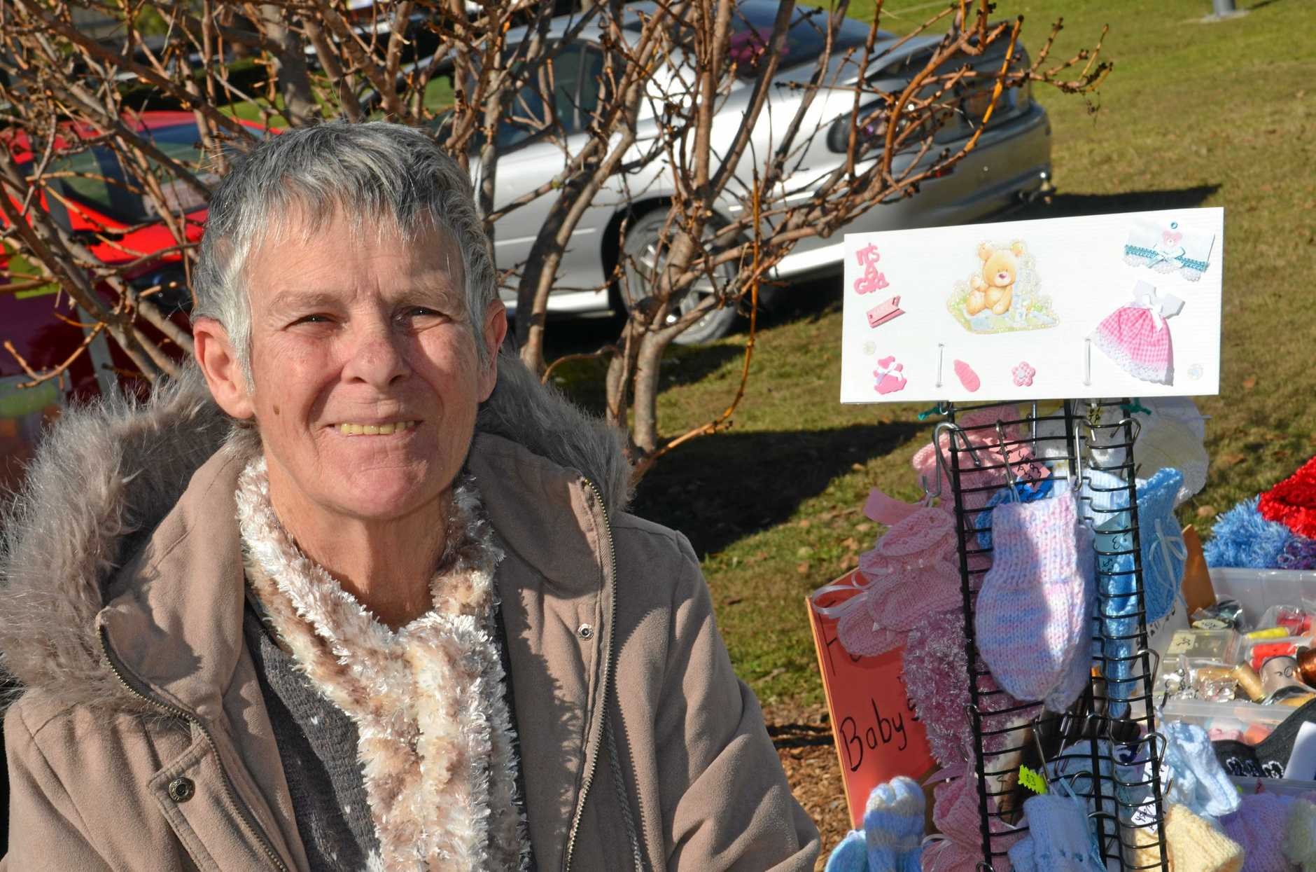 GENEROUS HEART: Maggie Kask sells her hand-knitted items for her charity which helps get people back on their feet.