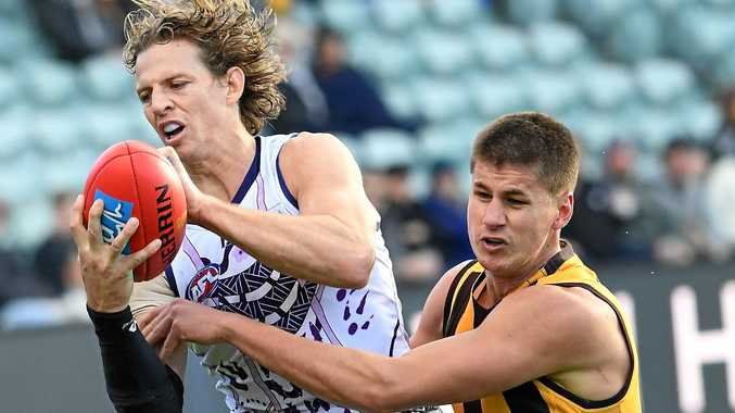 Hawks stay in finals hunt with win over Dockers