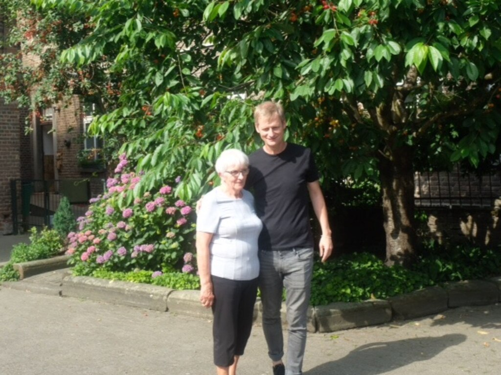 Norbert Winzen and his mother Kathi in courtyard of their threatened farmstead.