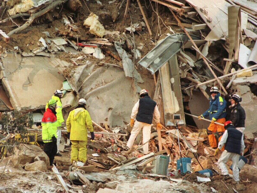 Rescuers worked under the constant threat of further slides.