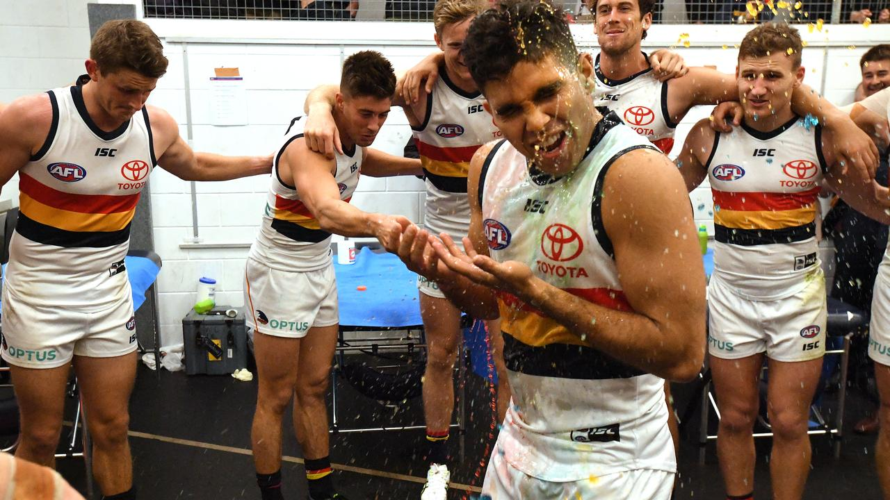 Tyson Stengle of the Crows celebrates during the team song following the win over the Suns. Picture: AAP Image/Dave Hunt