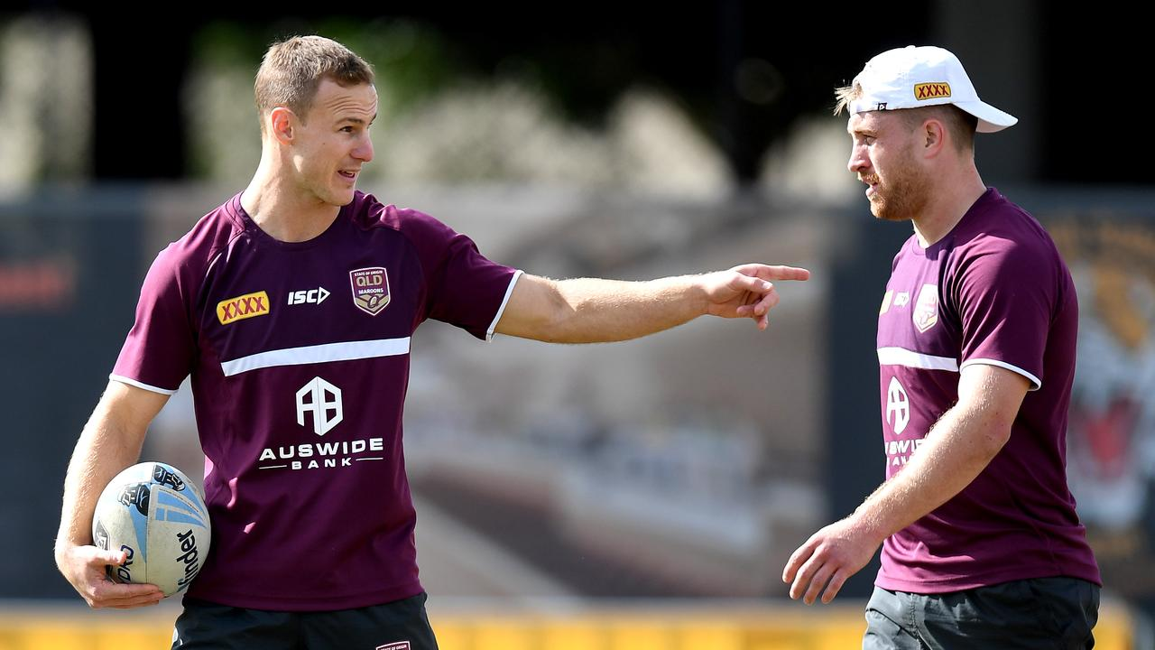 BRISBANE, AUSTRALIA - JULY 04: Daly Cherry-Evans and Cameron Munster talks tactics during a Queensland Maroons State of Origin training session at Langlands Park on July 04, 2019 in Brisbane, Australia. (Photo by Bradley Kanaris/Getty Images)