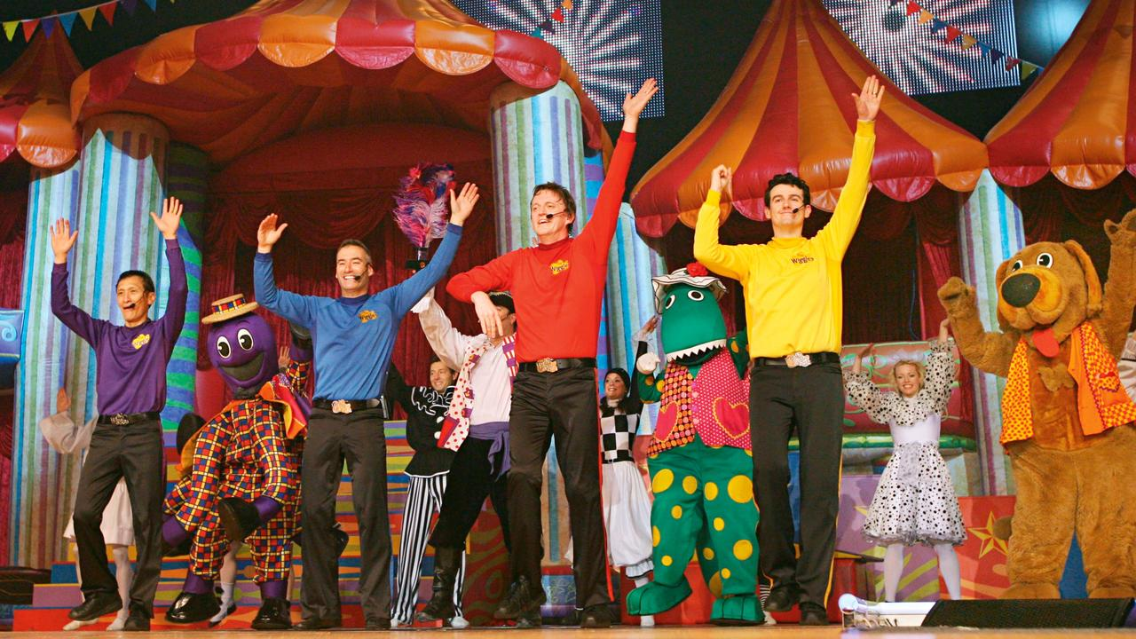 Donning the yellow skivvy onstage with The Wiggles (from left) Jeff Fatt, Anthony Field and Murray Cook in 2008. (Picture: Supplied)