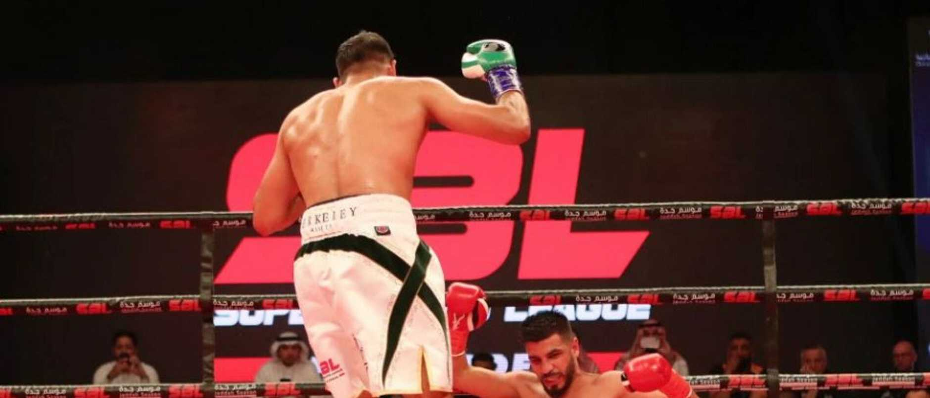 Amir Khan floors Billy Dib. Picture: Dave Pinegar