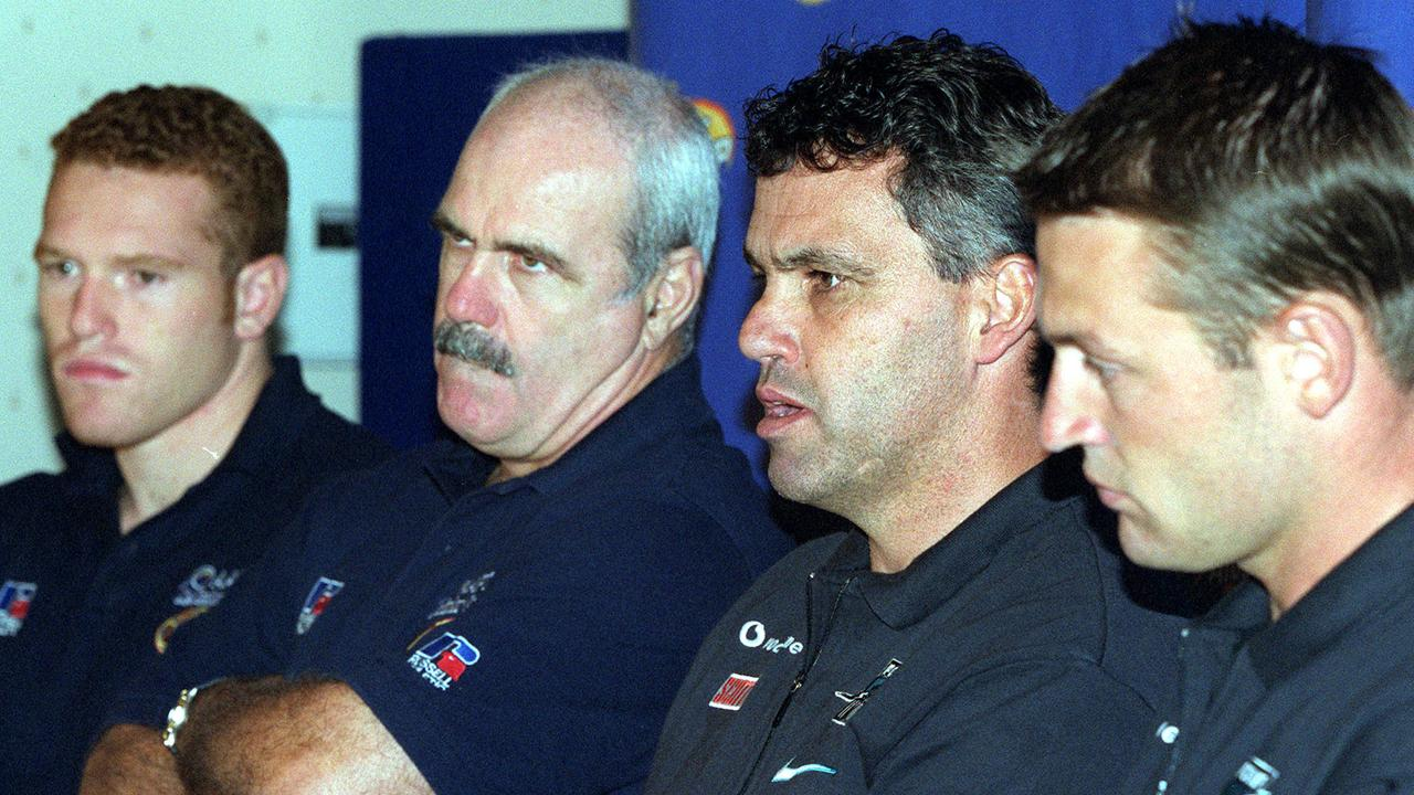 Footballer Justin Leppitsch (l) with (l-r) coach Leigh Matthews, Mark Williams and Matthew Primus at Ansett Cup grand final press conference 16 Mar 2001.