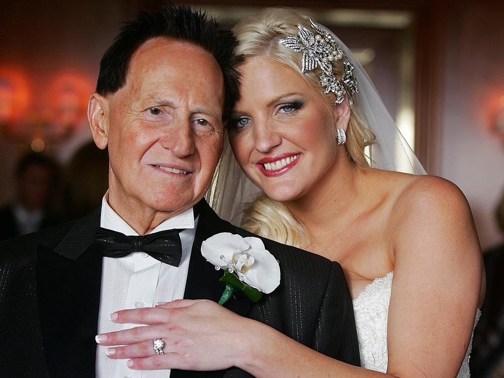 Geoffrey Edelsten and his new bride posed for photographers after the wedding in 2009. Picture: Great Expectations Foundation Ltd/Getty Images