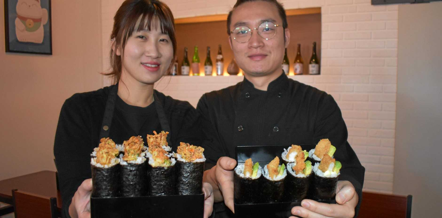ON A ROLL: Jin Young Choi and Sung Ho Kim show off their favourite sushi.