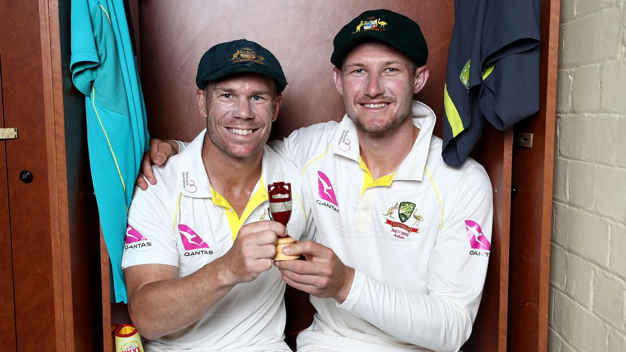 Happier times: David Warner and Cameron Bancroft celebrate with the Ashes Urn in the change rooms after the Fifth Test of the 2017/18 Ashes Series. Picture: Ryan Pierse/Getty Images