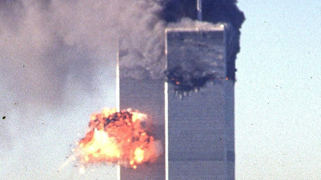SEPTEMBER 11, 2001 : This 11/09/01 file photo shows the north tower of the World Trade Center smoldering (forground) as the south tower (background) explodes as it is impacted by the second hijacked airliner, United Airlines Flight 175. The north tower was hit first by the hijacked American Airlines Flight 11. USA / Crime / Bombing / Terrorism