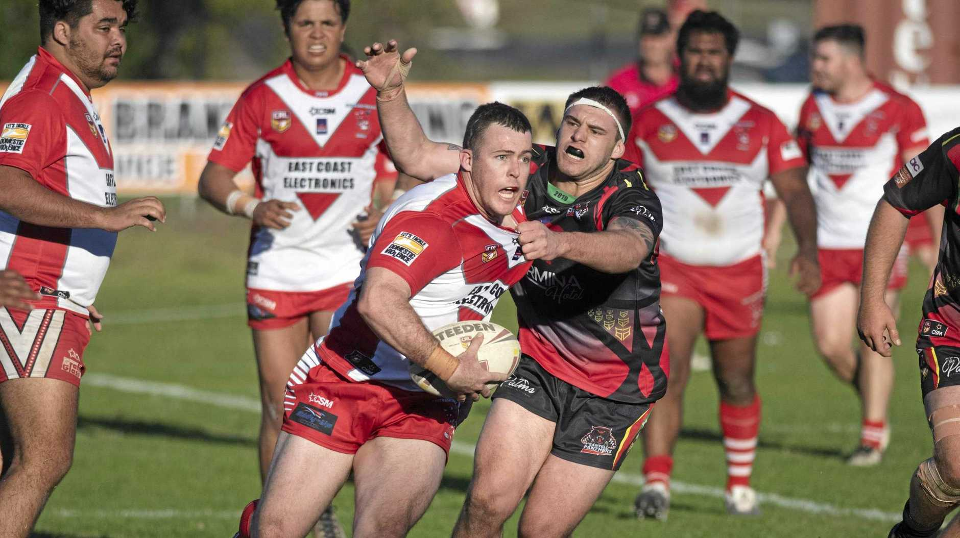 DREAM TEAMWORK: South Grafton Rebels returning captain Luke Welch runs the ball against Sawtell at McKittrick Park. Teammate Allen McKenzie (centre, left)  starred in the game with two tries and an assist.