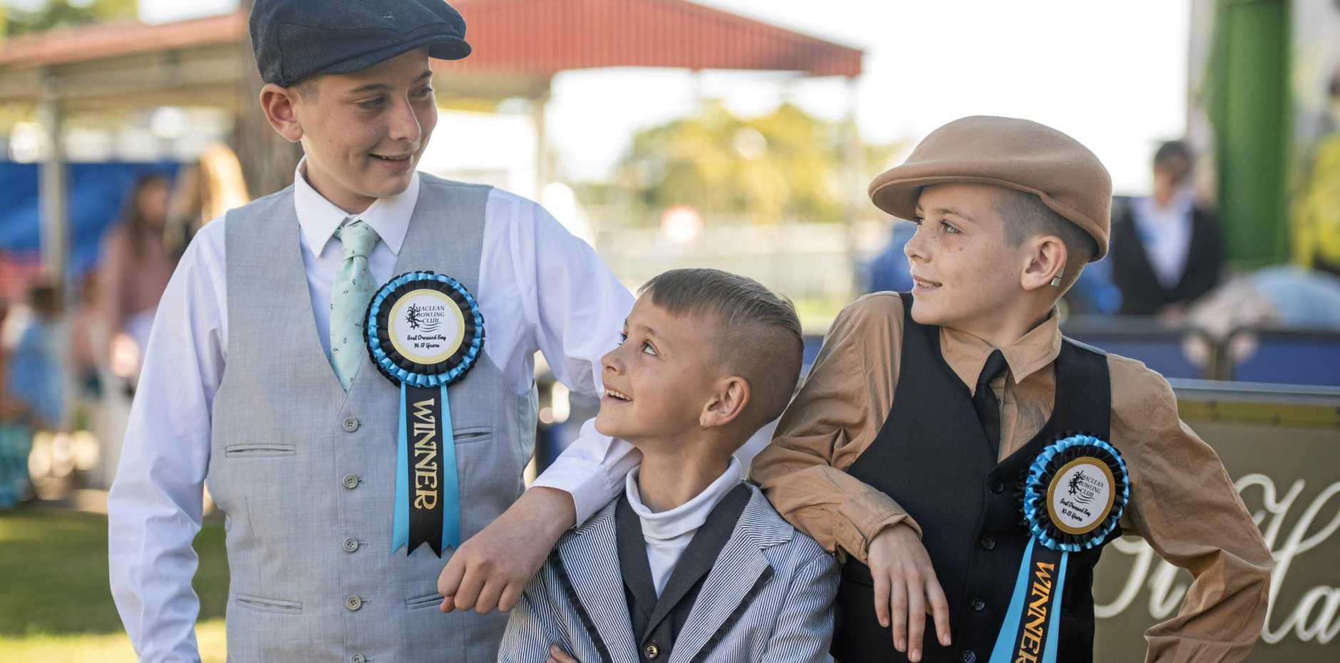 FAMILY AFFAIR: EYE FOR STYLE: Rylan, Jye and Logan Cone compare their prizes from the different categories of the Maclean Bowling Club kids Fashion on the Field competitions.