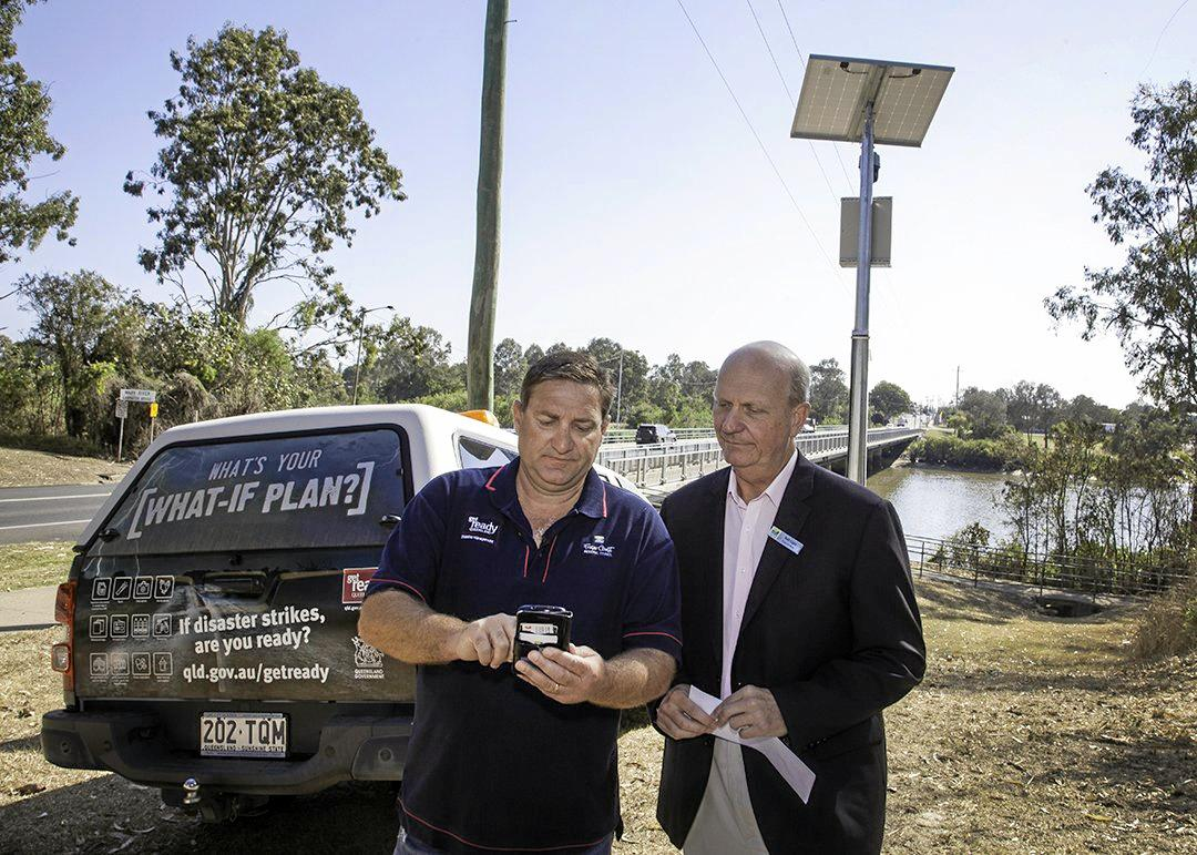FLOOD PREPARED: Local Disaster Management Group Chair Councillor Rolf Light (right) and Disaster Planning Coordinator Brendan Guy at the installation of the Lamington Bridge flood camera in September last year. Three new flood cameras will be added to Maryborough's network after a funding grant from the State Government.