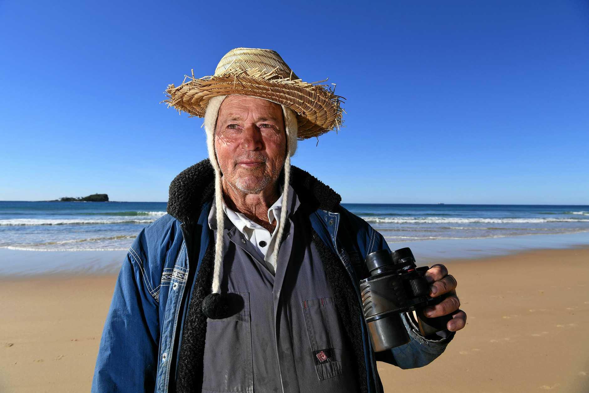 rTom Durbidge waiting for mullet on Mudjimba Beach.