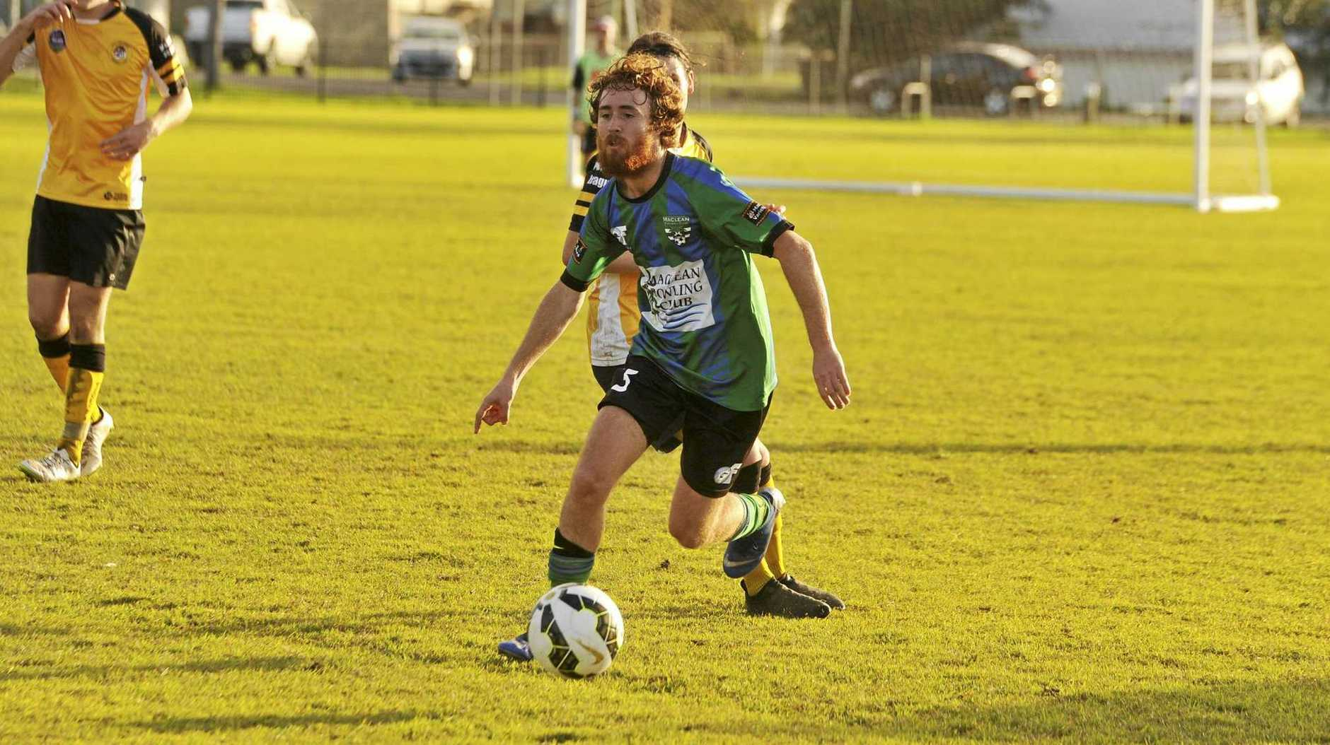 ON THE CHARGE: Maclean Bobcat Nathan Shugg in a game against the Westlawn Tigers at Barry Watts Oval last month.