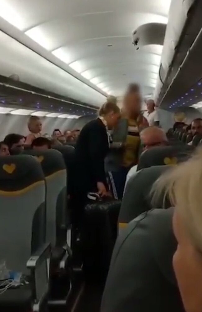 Sickening footage shows the vile tourist hurling abuse at passengers in white prayer robes