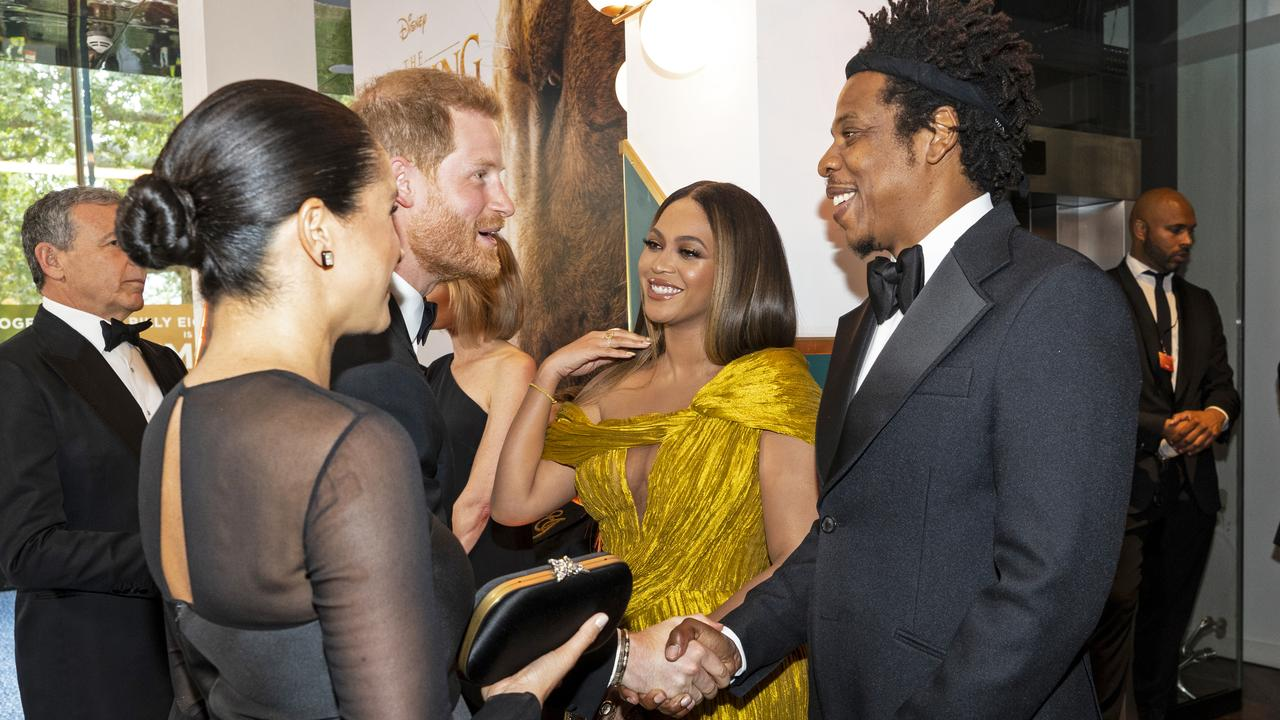 Prince Harry and Jay-Z shake hands. Picture: Niklas Halle'n-WPA Pool/Getty Images