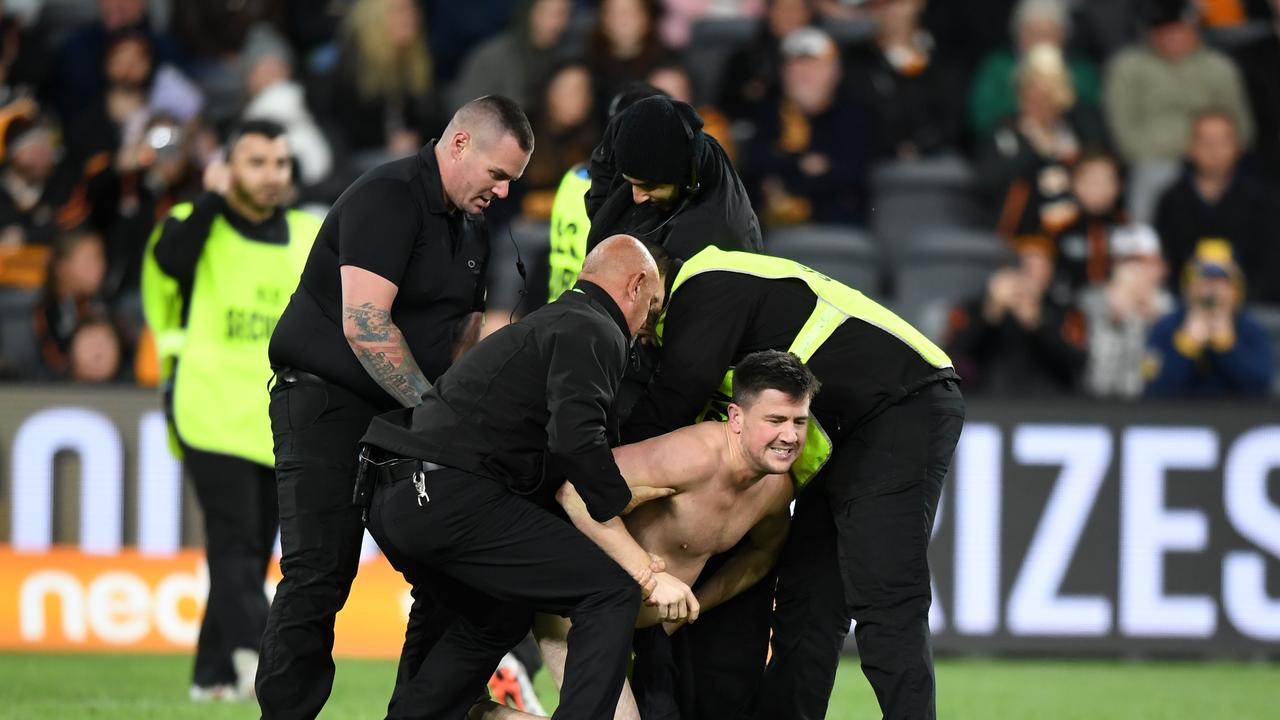 Security eventually caught up with the streaker. Picture: AAP
