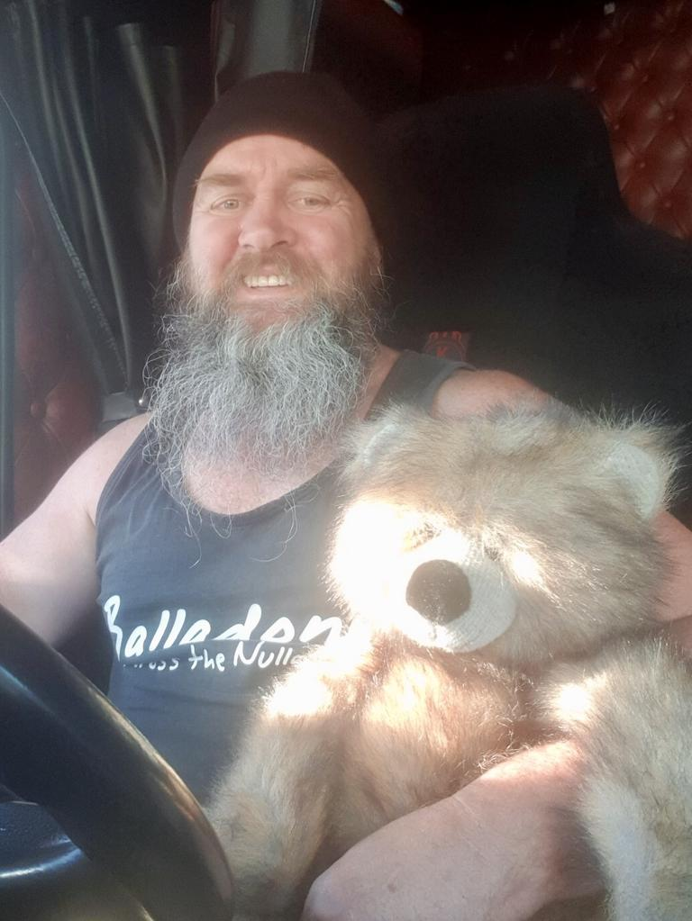 Townsville truck driver Andy Kmet rides with a trauma teddy in case he comes across another crash on the Bruce Highway involving children. Photo: Supplied