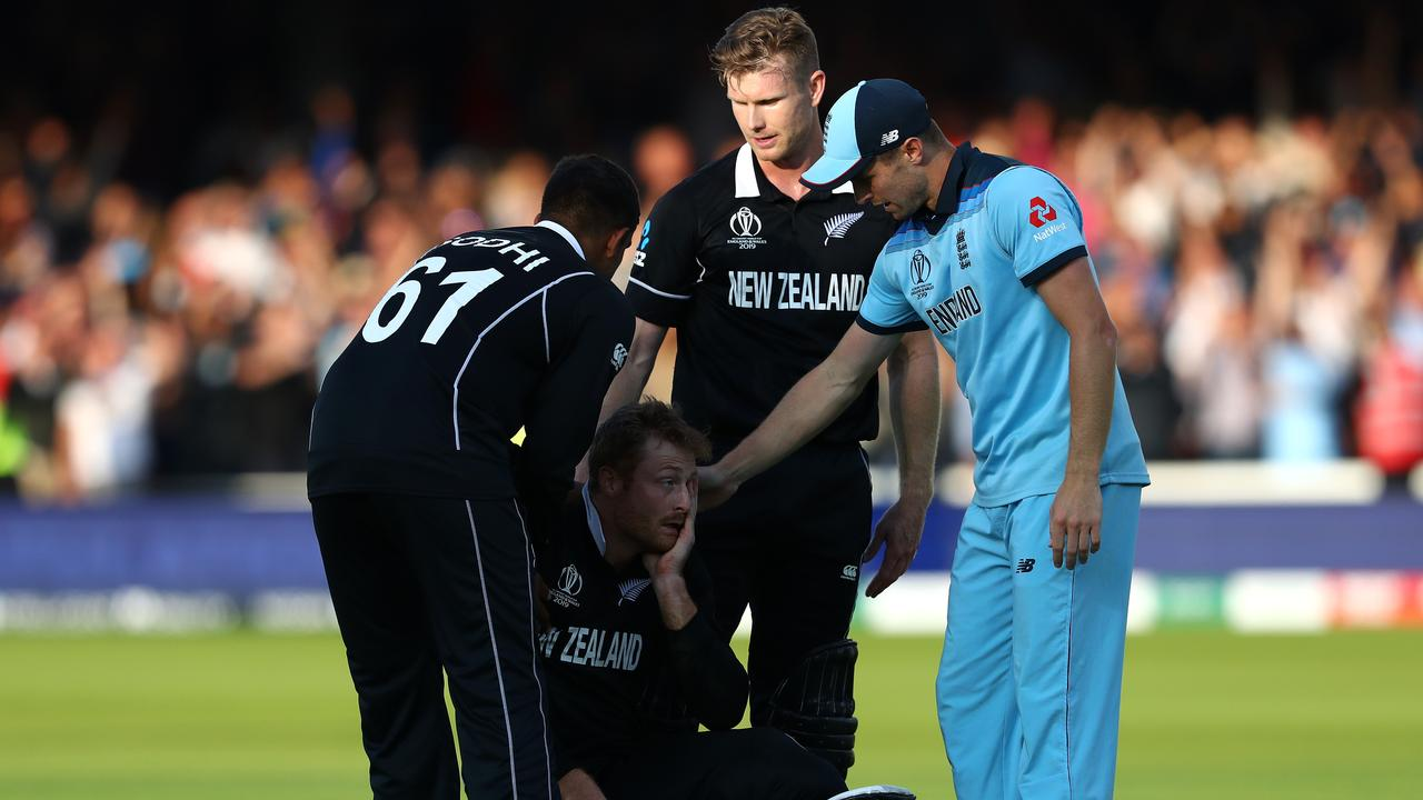 Martin Guptill is consoled by teammates and Chris Woakes. Picture: Getty