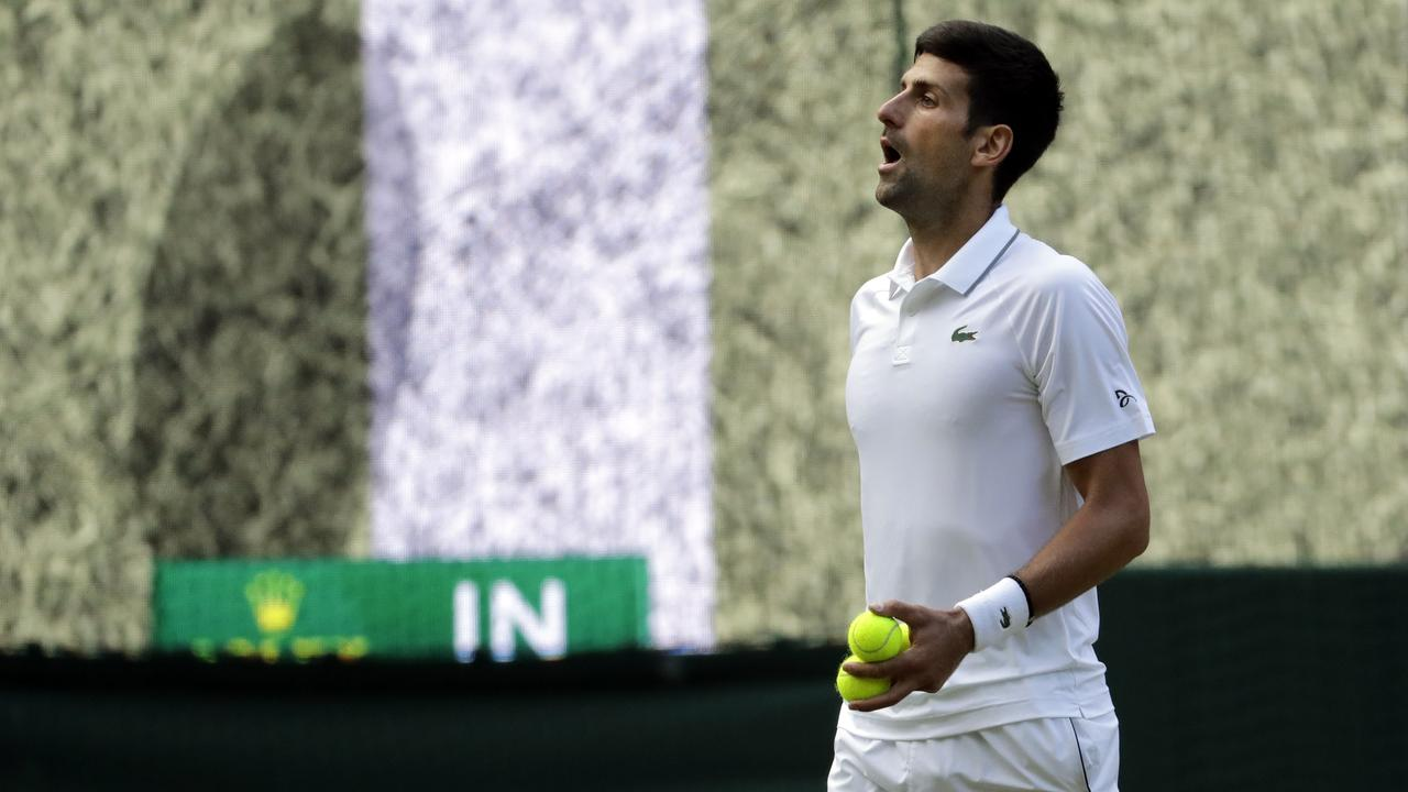 Serbia's Novak Djokovic reacts as the ball is called in. (AP Photo/Ben Curtis)