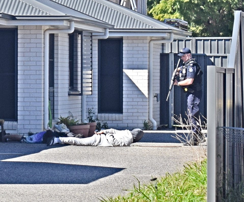 ON THE SCENE: An armed police officer directed two men outside a Chinchilla home at gun point after one walked down a street with a gel blaster.