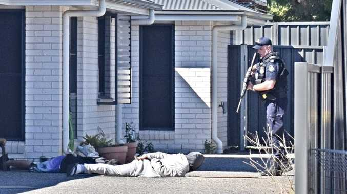 Police draw rifles in dramatic arrest on suburban street