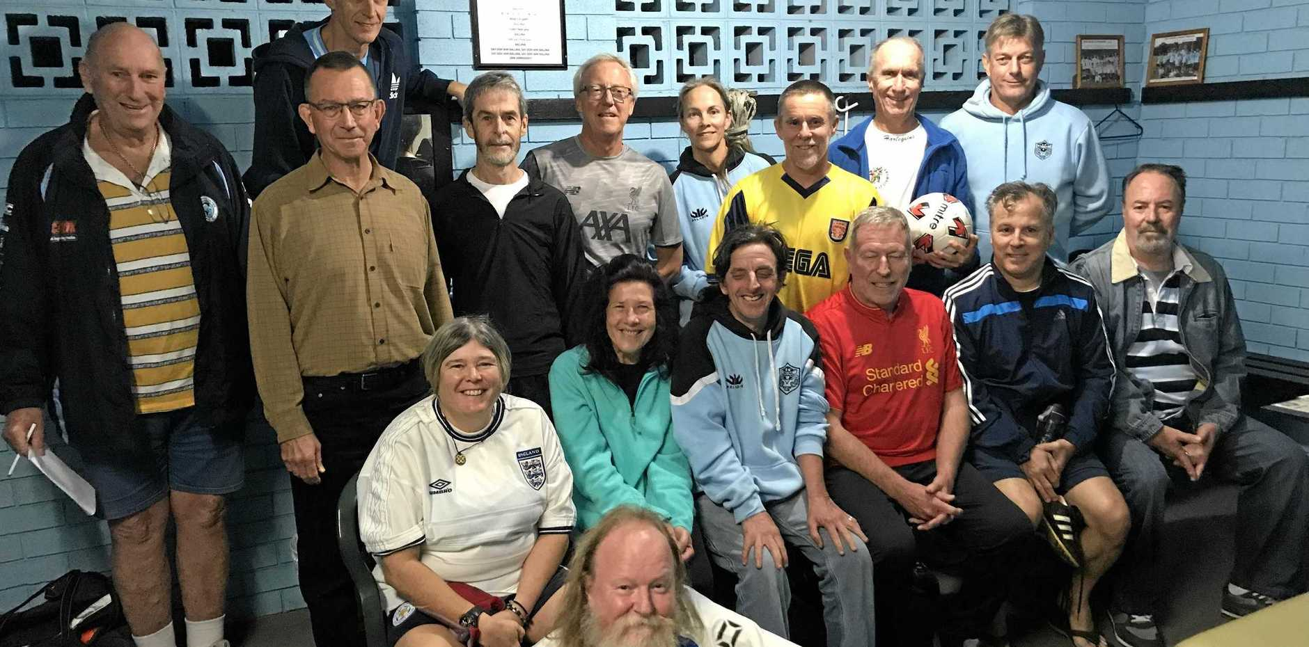FOOTIE FANS: John Galletly (middle grey top) and Paul Connellan (holding the ball) with some of the crew.