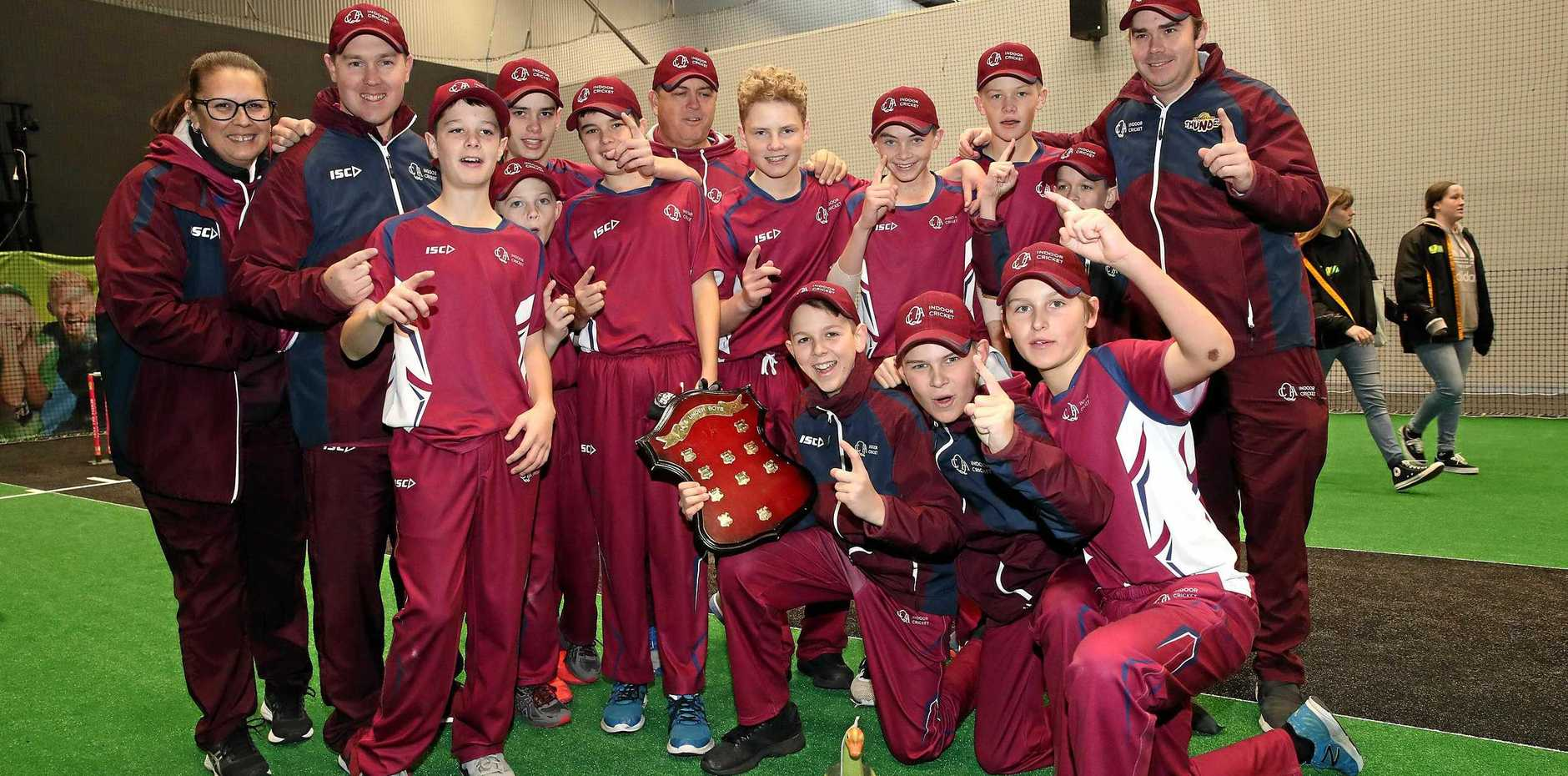 CHAMPIONS: The Queensland Under-13 Indoor Cricket side celebrate their big grand final victory over Western Australia.