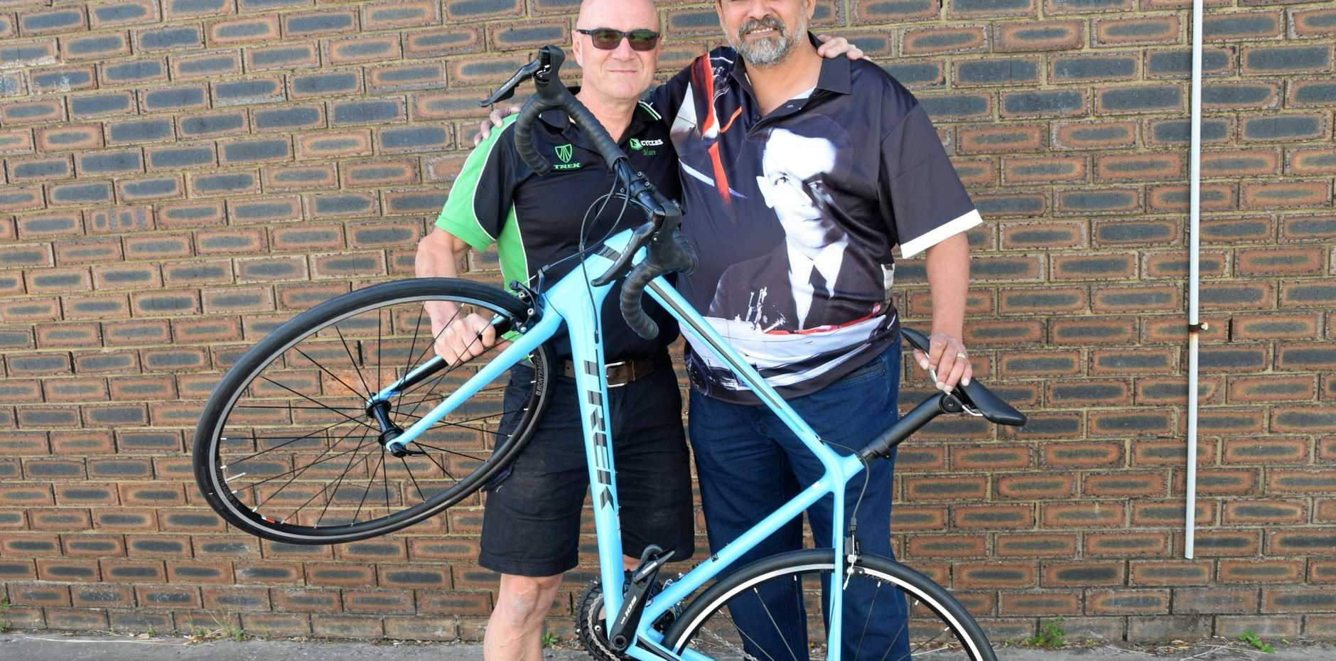 NEW HOPE: Veteran Reg Armstrong (right) has been donated a bicycle from M1 Cycles Gladstone owner Matt Jenkin as part of the Veteran Sport Australia program which helps veterans suffering from mental illness.