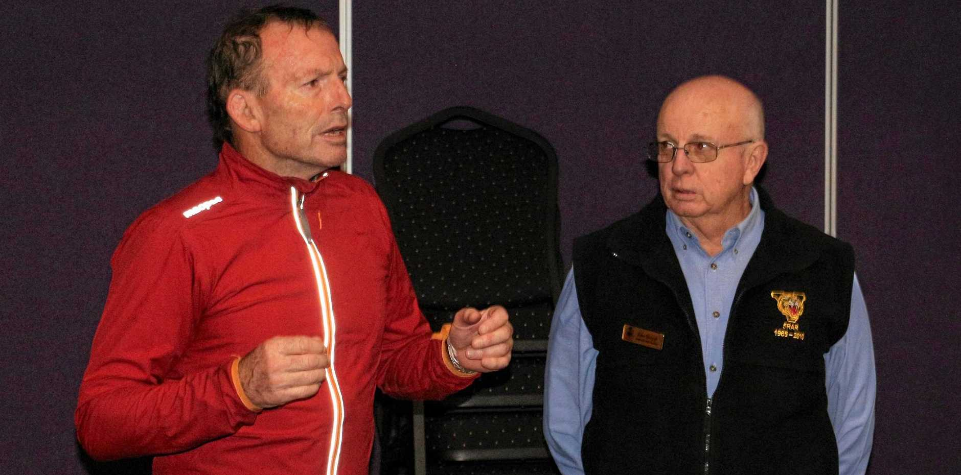 VISIT: Former prime minister Tony Abbott discusses charity work with sub-branch president John Skinner.