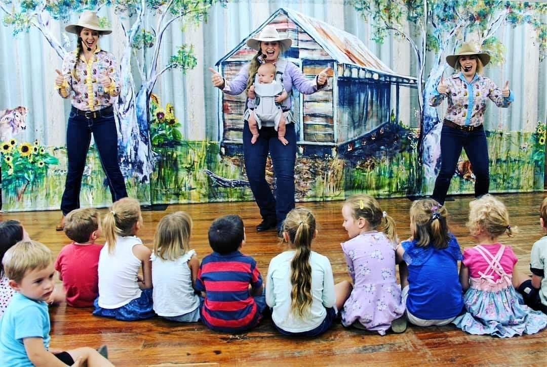 Blue Gum Farm TV performing in front of the backdrop painted by Amy Wood (nee Slack).