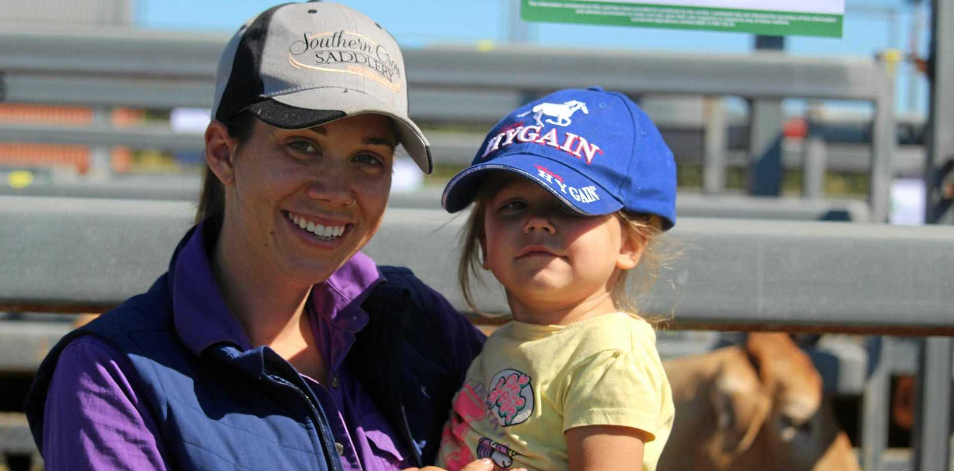 Sarina residents, Alyssa Hills and 3-year-old Gracie Hills at the Landmark Sarina Cattle auction.