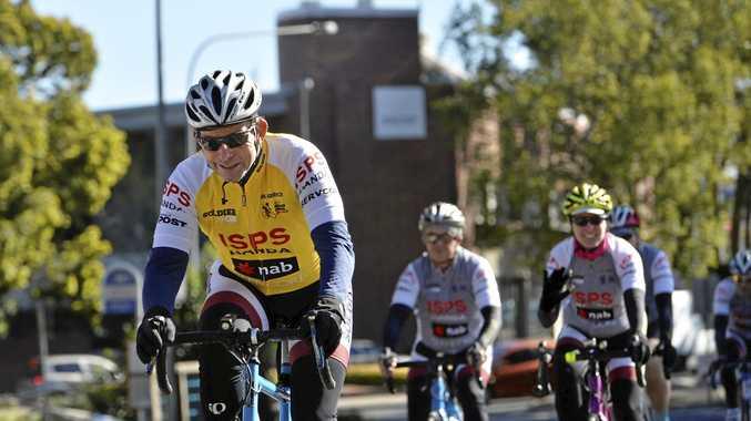 Former PM Tony Abbott pedals into Toowoomba