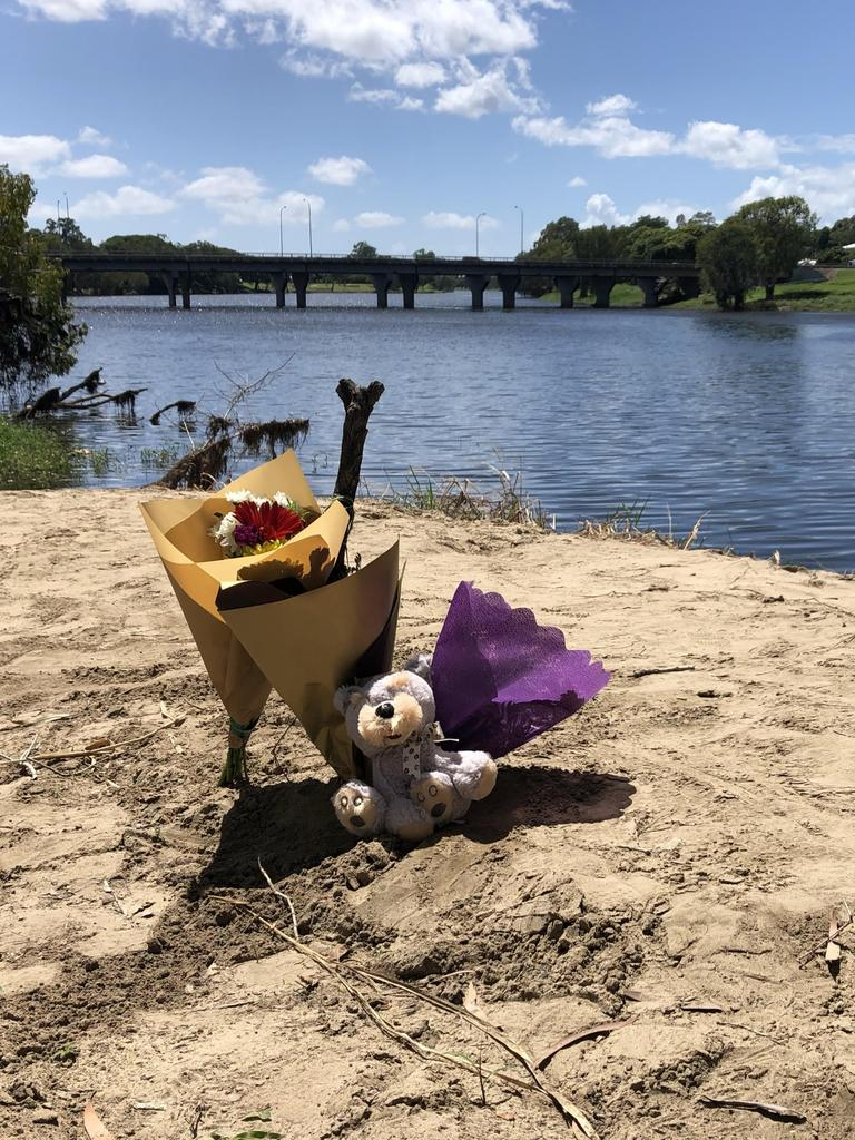Flowers were laid for Barak Austral, 5, and Jhulio Sariago, 3, found dead in the Ross River. Picture: Madura McCormack