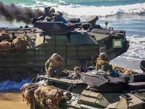 Let the invasion begin! Coalition troops storm beach
