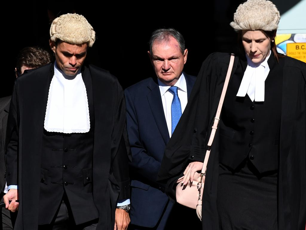 Former Ipswich mayor Paul Pisasale (centre) arrives at the District Court in Brisbane. Picture: AAP/Dan Peled