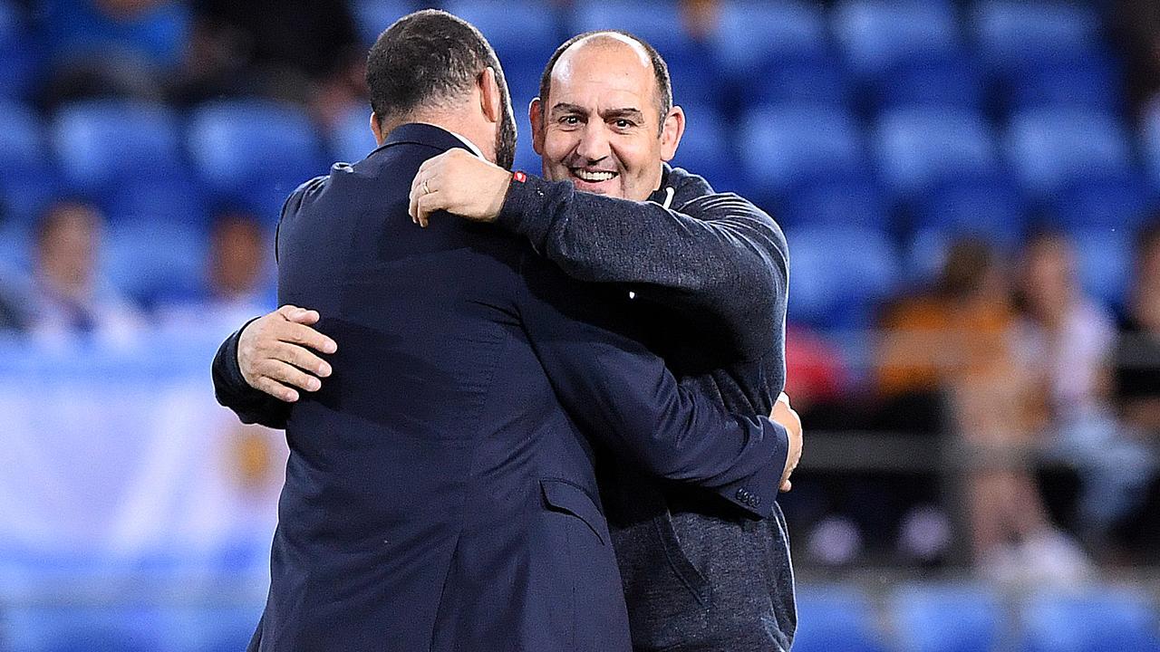Pumas coach Mario Ledesma embraces Wallabies coach Michael Cheika prior to kick-off.