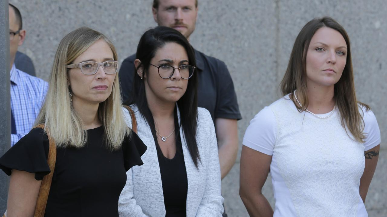 Annie Farmer, left, and Courtney Wild, right, accusers of Jeffery Epstein, stand outside the courthouse in New York, Monday, July 15, 2019. Picture: AP/Seth Wenig.