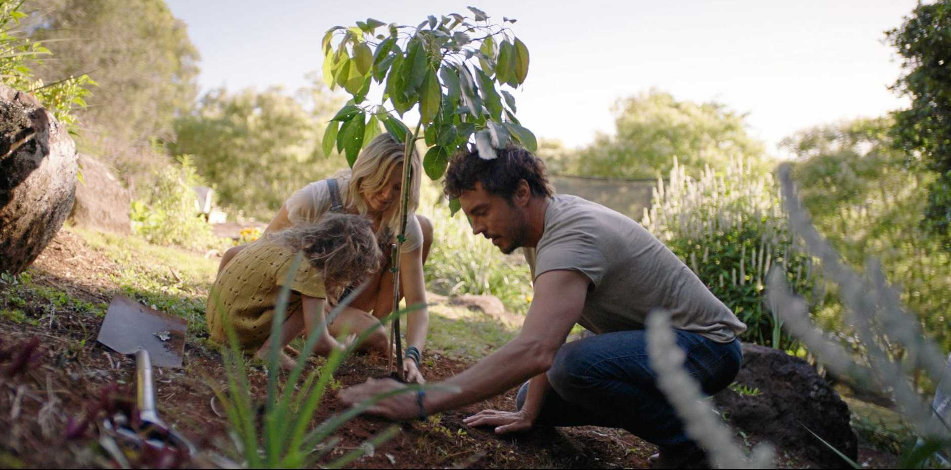 A still from the film sustainability documentary 2040 featuring filmmakers Zoe and Damon Gameau and their daughter Velvet.