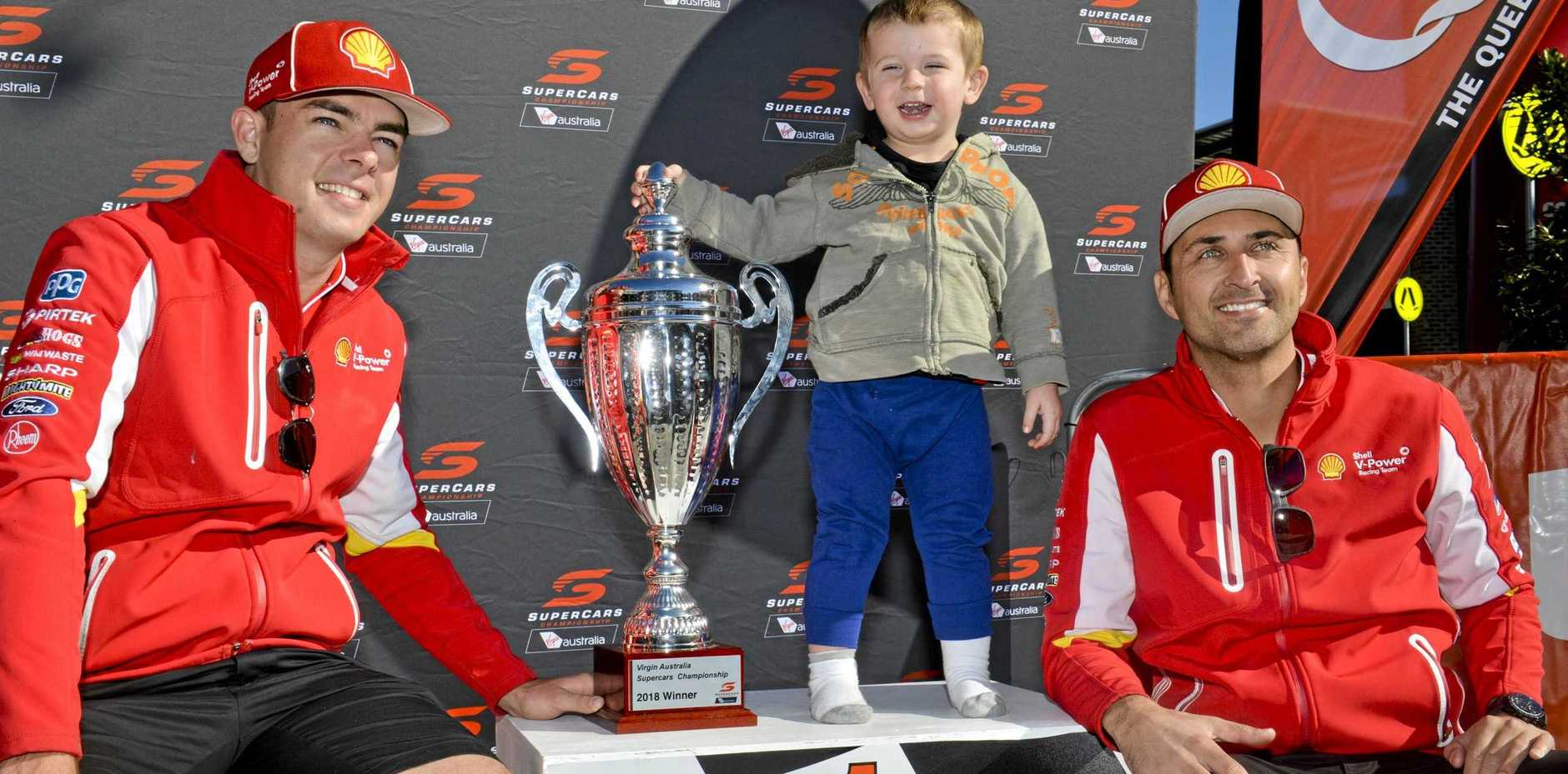 Supercars frontrunners Scott McLaughlin and Fabian Coulthard get a pic with a young fan at last year's community day at Orion Shopping Centre.