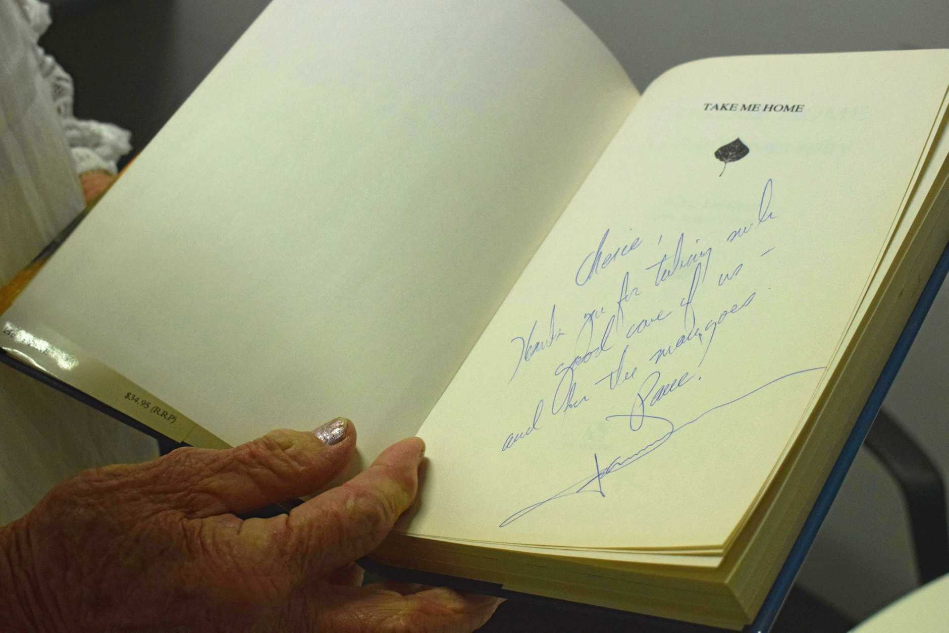 Cherie Weatherall reminisces on the time she took John Denver to perform at the Music Bowl and he gifted her a signed copy of his book.
