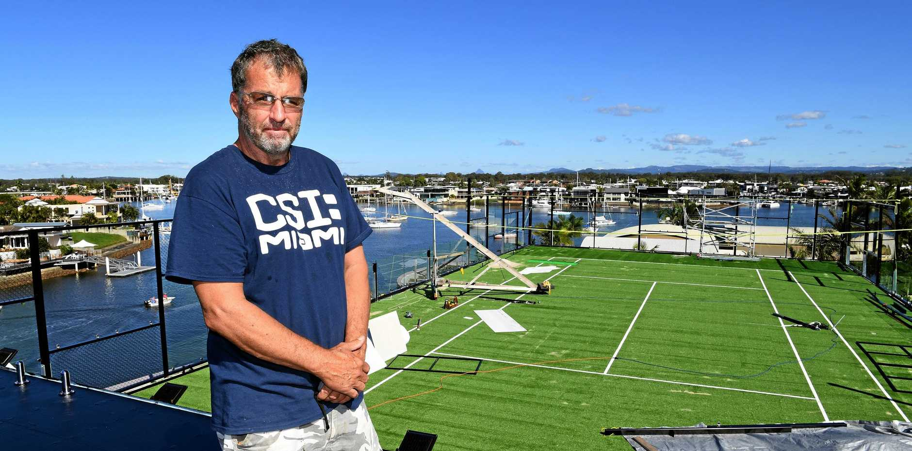 Wayne Dwyer is building a tennis court on top his his Minyama home. Some nearby residents have objected, while support has started to come in.