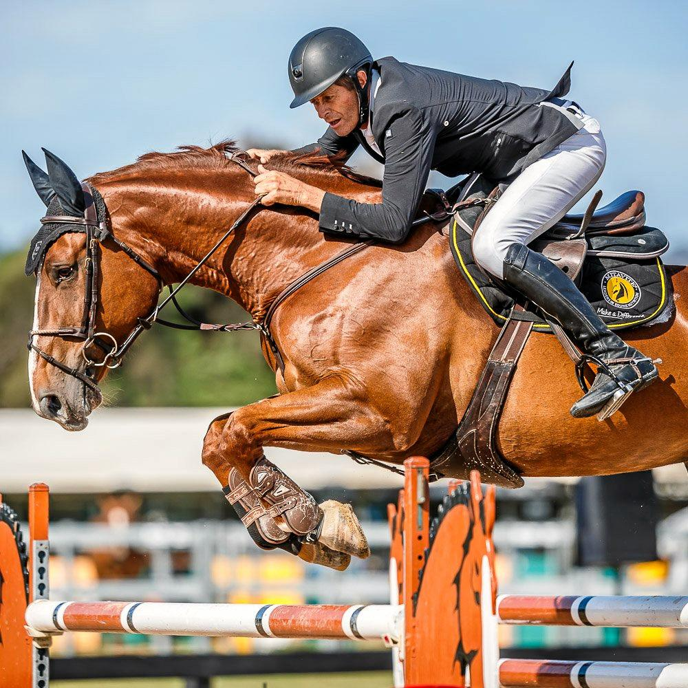 SHOW JUMP: Clem Smith and his horse Alite make a jump.