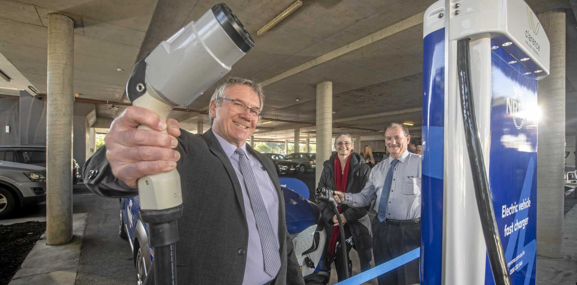 Clarence Valley Council general manager Ashley Lindsay is joined by NRMA executive general manager motoring Nell Payne and Mayor Jim Simmons at the launch of NRMA's fast charging station under the Grafton Library.