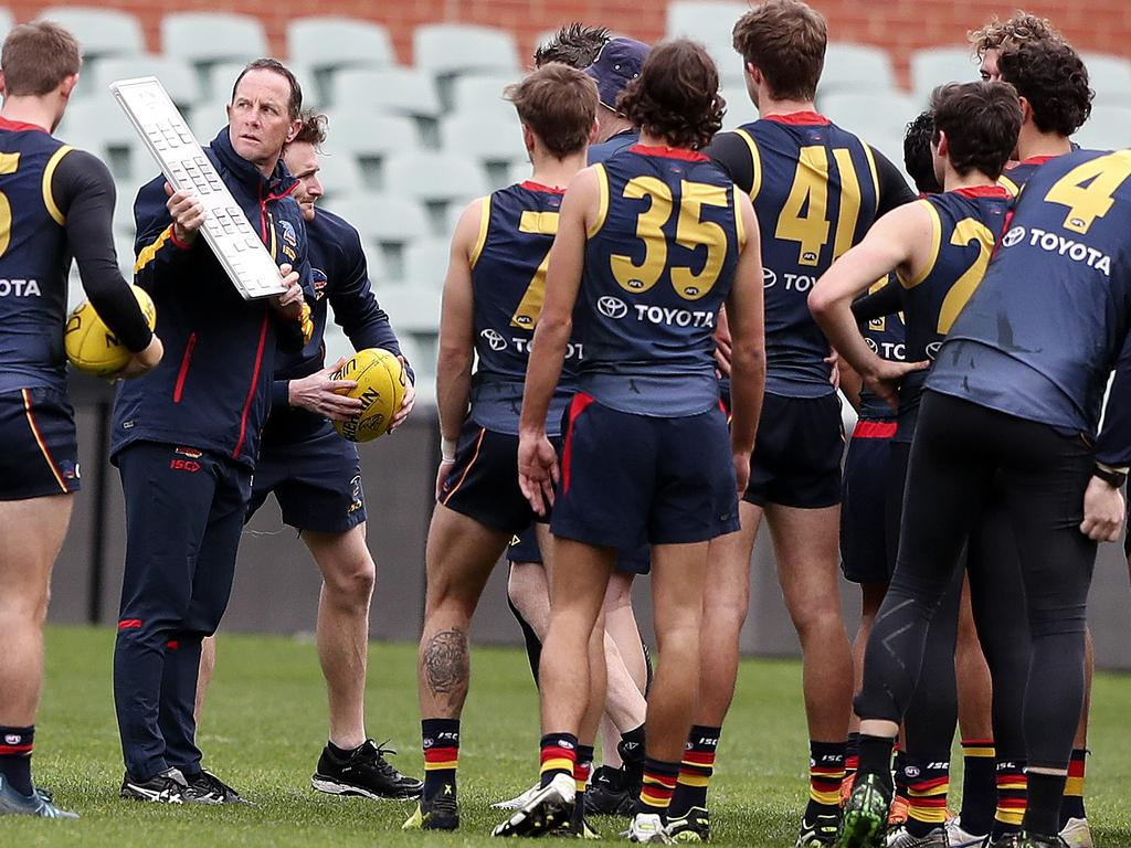 Don Pyke talks to his players at the start of an open training session at Adelaide Oval on July 17, 2019. Picture Sarah Reed