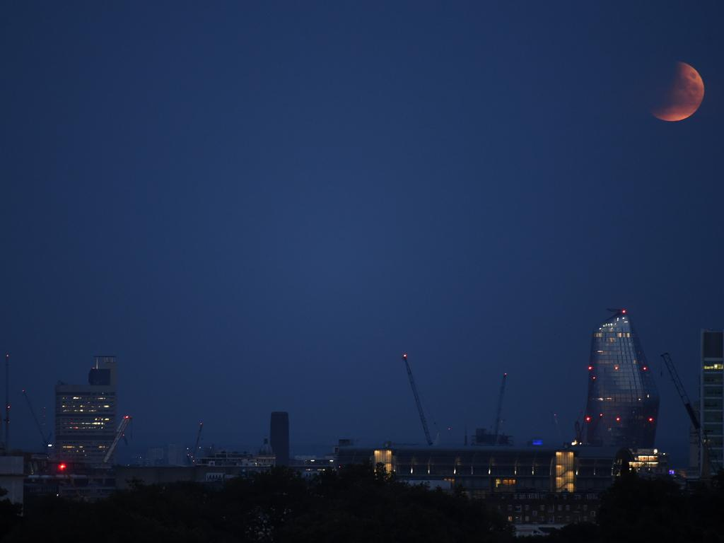The partial lunar eclipse as it appeared over the London skyline. Picture: Getty Images