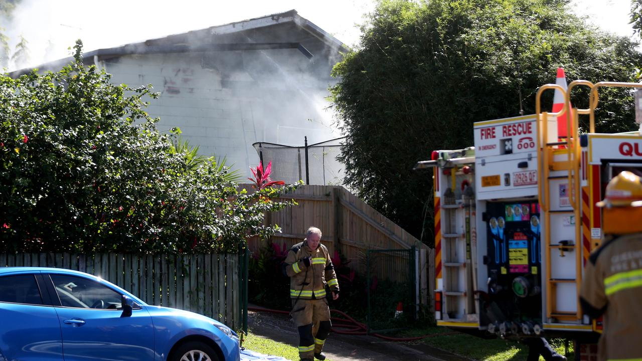 Fire fighters extinguishing a large house fire on McManus St, Whitfield. PICTURE: STEWART MCLEAN